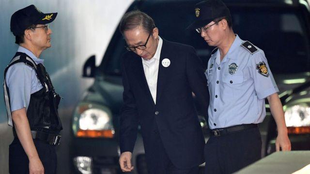Former president Lee Myung-bak arriving at court in Seoul in September