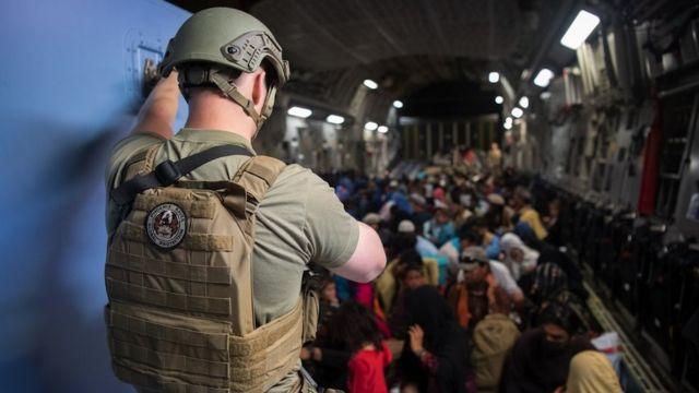 A US aircraft evacuating Afghans