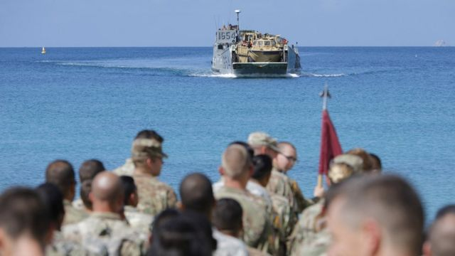 Image shows US soldiers waiting to be evacuated on a beach in the US Virgin Islands on 17 September 2017