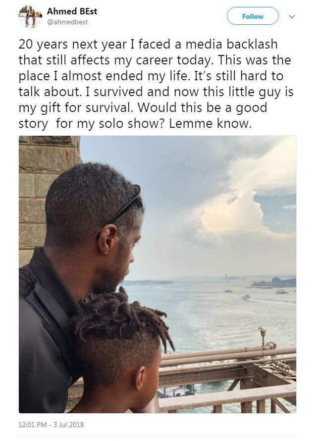 """A picture of Ahmed Best with his young son facing away from the camera, and a tweet reading: """"20 years next year I faced a media backlash that still affects my career today. This was the place I almost ended my life. It's still hard to talk about. I survived and now this little guy is my gift for survival. Would this be a good story for my solo show? Lemme know."""""""