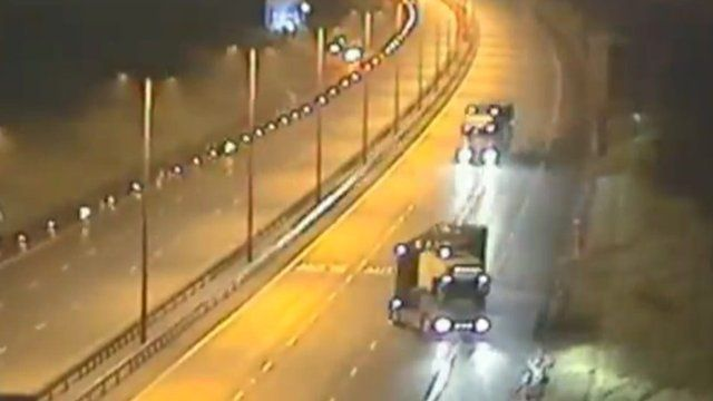 The lorry reversing across the carriageways