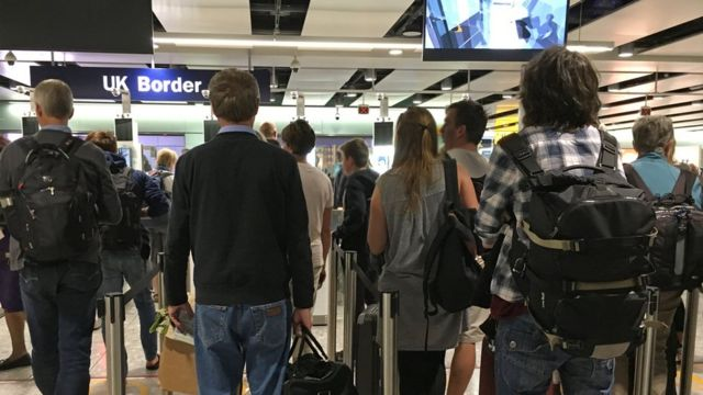 People queue for the biometric gates at Heathrow