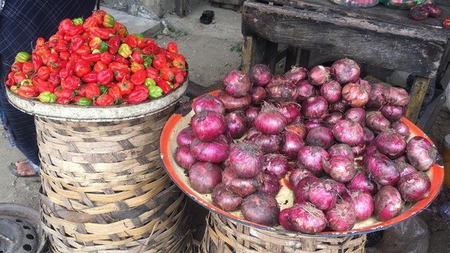 Baskets of Pepper and Onions