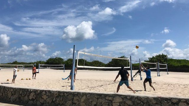 Young people playing volleyball on South Beach