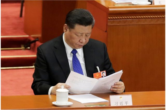 """Chinese President Xi Jinping reads a report at the fourth plenary session of the National People""""s Congress (NPC) at the Great Hall of the People in Beijing, China March 13, 2018. REUTERS/Jason Lee"""
