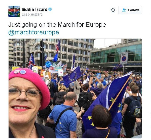 Eddie Izzard twitter picture of himself on the march wearing his trademark pink beret.