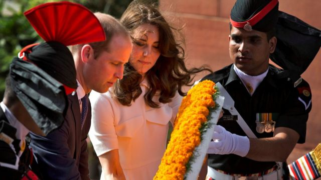 Prince William and his wife Catherine, the Duchess of Cambridge, place a wreath as they pay their tributes at the India Gate war memorial in New Delhi
