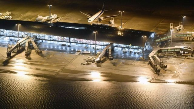 An aerial view shows a flooded runway at Kansai airport, Osaka on 4 September 2018