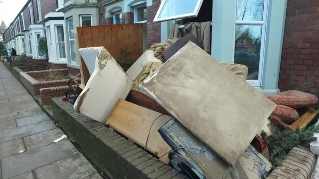 Furniture outside a house damaged by storms in Warwick Road, Carlisle