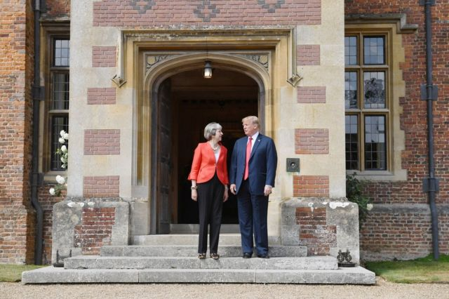 President Donald Trump and Prime Minister Theresa meet on the doorstep of Chequers in Buckinghamshire
