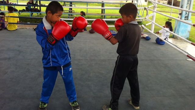 Two boys practice boxing at a Manipur training camp