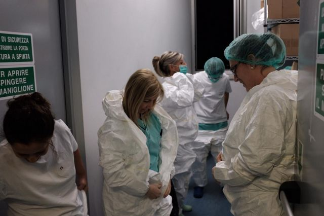 Hospital staff put on protective clothing