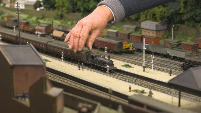 Man holding railway model