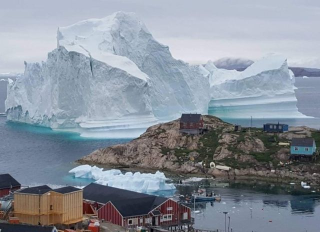 Huge iceberg threatens Greenland village
