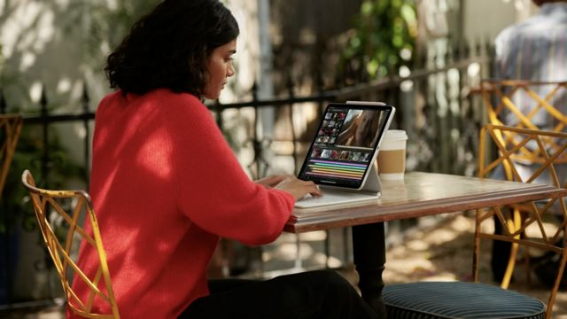 Girl watching a new iPad