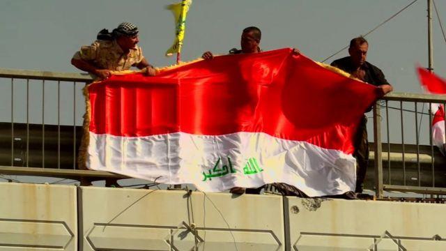 Flag of Iraq is unfurled in Falluja