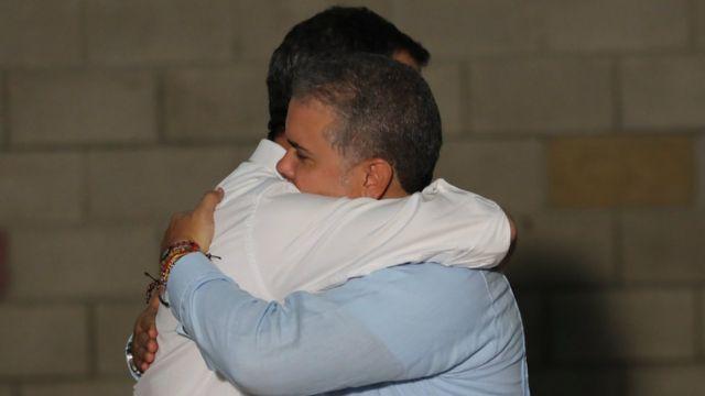 Guaidó embraces Colombia's President Ivan Duque