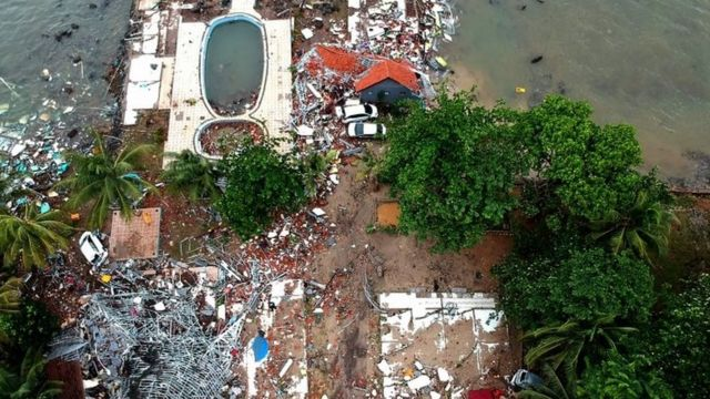 An aerial photo showing damaged buildings in Carita