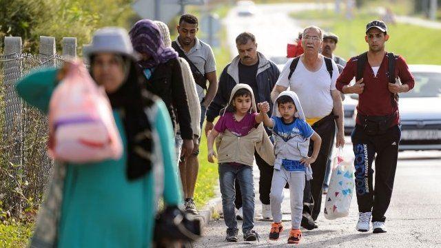 Migrants walk on the Croatian side of the Slovenska vas-Bregana border crossing between Croatia and Slovenia