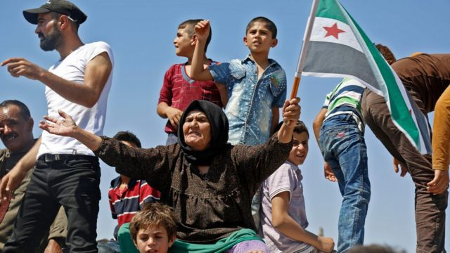 Syrian protesters chant slogans at a protest against the Syrian government and Russia in the rebel-held town of Maarat al-Numan, Idlib province (31 August 2018)