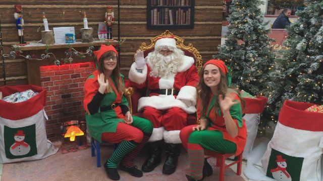 Santa Claus and two elves at St Elli, Llanelli