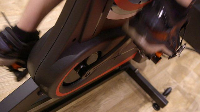 A person on an exercise bike
