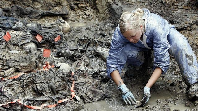 Rescue of bodies in mass graves in Bosnia.