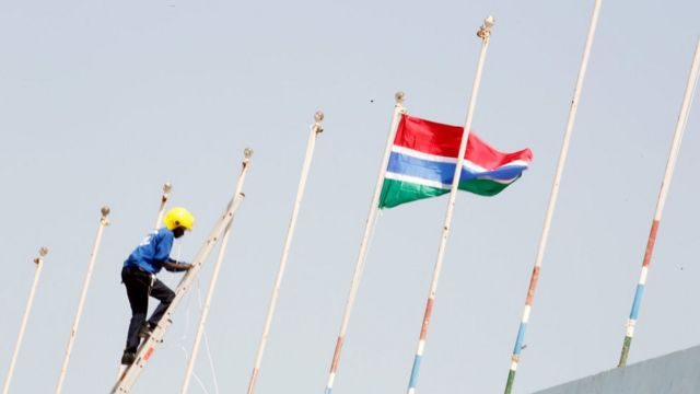 The Gambia's flag is hoisted above Independence Stadium for President Barrow's inauguration ceremony