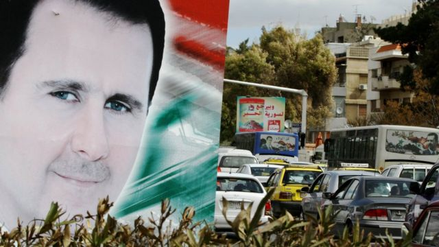A photo taken on March 4, 2015 shows a banner bearing a portrait of Syrian President Bashar al-Assad in a street in the city of Damascus.
