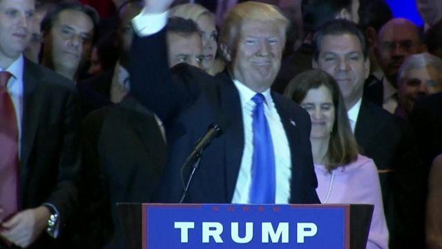 Trump at podium waving