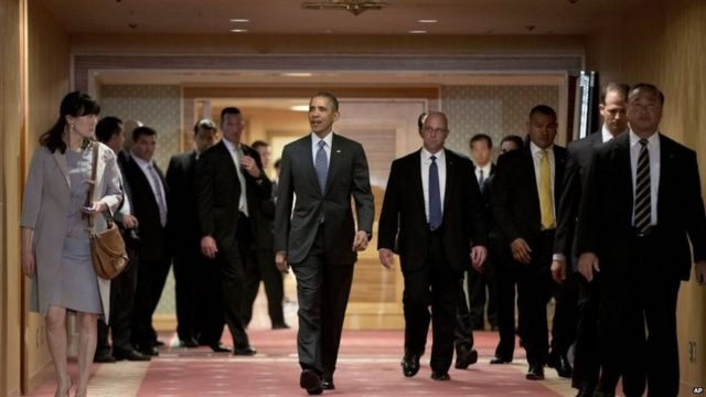 U.S. President Barack Obama walks to greet Japan's Emperor Akihito and his wife Empress Michiko as they arrive at the Okura Hotel in Tokyo 25 April 2015