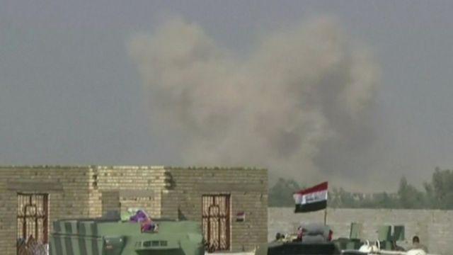 Smoke rises from Falluja