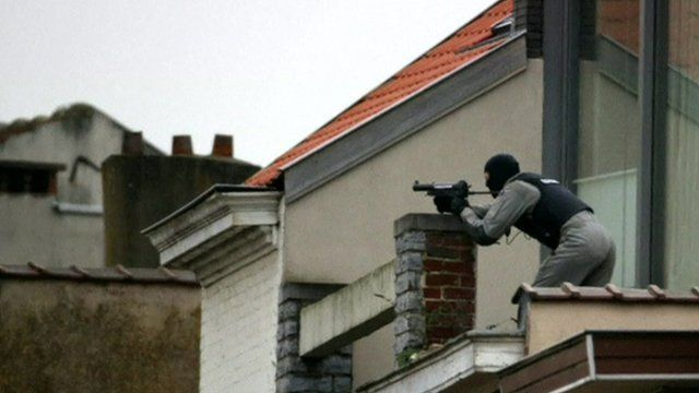A police sniper on a roof in Brussels