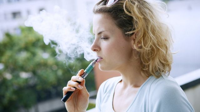 Woman smoking e-cigarette