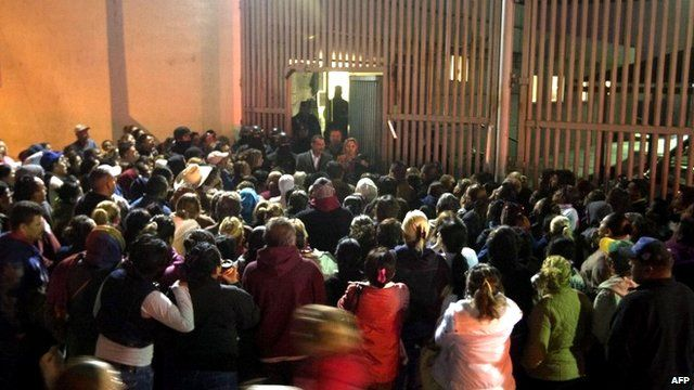 Relatives of inmates gather outside the Topo Chico prison in the northern city of Monterrey in Mexico