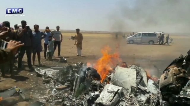 Still from Syrian rebel footage of Russian helicopter wreckage