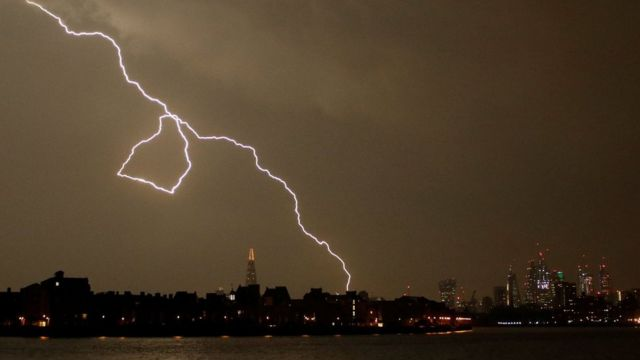 General view as lightning strikes over the city of London
