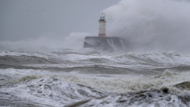 A lighthouse amid waves at Newhaven in East Susses during Storm Ciara