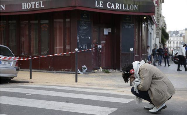 A woman mourns outside Carillon bar in Paris on 14 November, 2015