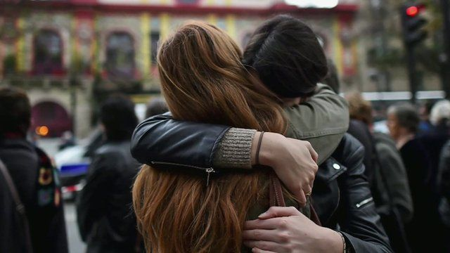 Parisians hug each other in support over the Paris attacks