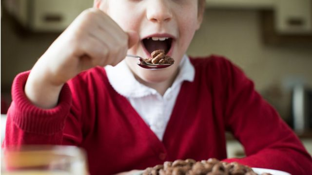 Child eating chocolate cereal