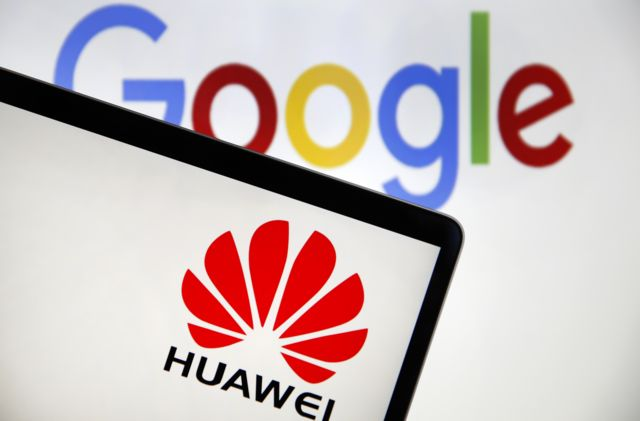 In this photo illustration, the logo of the Chinese company Huawei is displayed on the screen of a laptop in front of a computer screen displaying the logo of Google on May 22, 2019 in Paris, France
