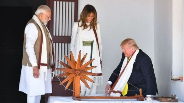 Mr and Mrs Trump tried their hand at spinning cloth, while Mr Modi (left) looked on