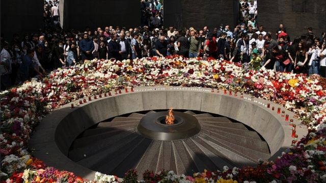 People take part in a commemorative ceremony for 1.5 million Armenians killed in the Ottoman-era slaughter at the Tsitsernakaberd Armenian Genocide Memorial complex in Yerevan, Armenia, 24 April 2021