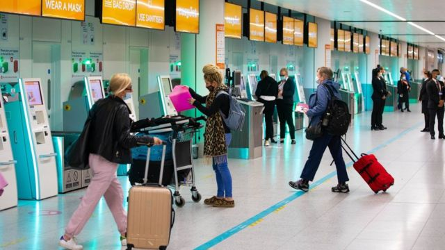 Passengers check in for the first holiday and leisure flight to take-off at Gatwick Airport, as easyJet relaunch flights from the UK to green-lit destinations today, for the first time this year