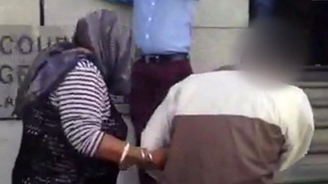 Arrival in court of the accused and her husband - faces have been obscured for legal reasons