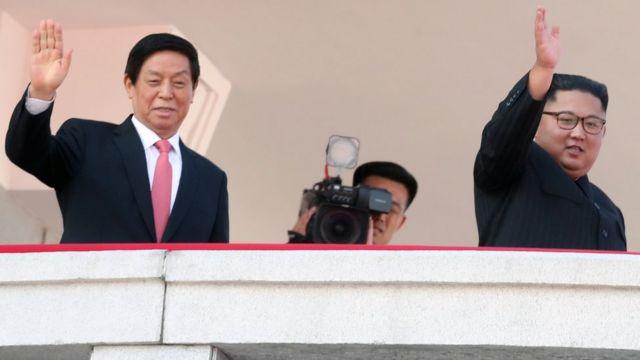 Kuzey Kore lideri Kim Jong-un da töreni izledi