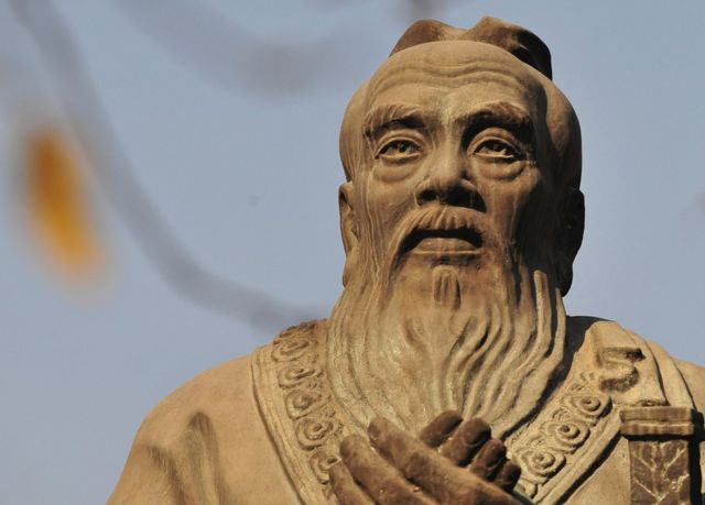 A statue of Confucius, the Chinese philosopher best known for promoting filial piety in the 6th century B.C, is pictured on the grounds of the Confucius Temple in Beijing on 22 November 2008