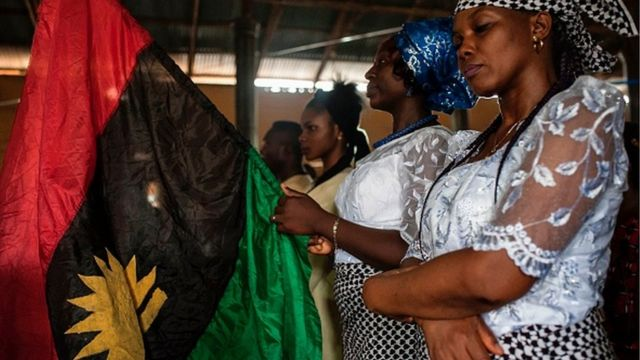 One woman hold one Biafran flag for one service for St. Martin Catholic of Tours Church May 28, 2017 inside Aba-South district, Abia State Nigeria