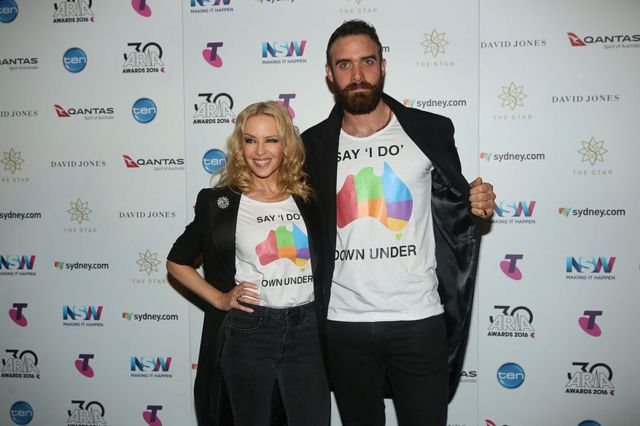 Kylie Minogue and Joshua Sasse pose in the ARIA awards room during the 30th Annual ARIA Awards 2016 at The Star on 23 November 2016 in Sydney, Australia.